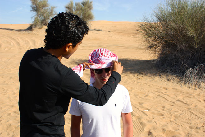 Platinum Heritage - Desert Safari Dubai - Breakfast with a Bedouin - Tying an arabian headscarf