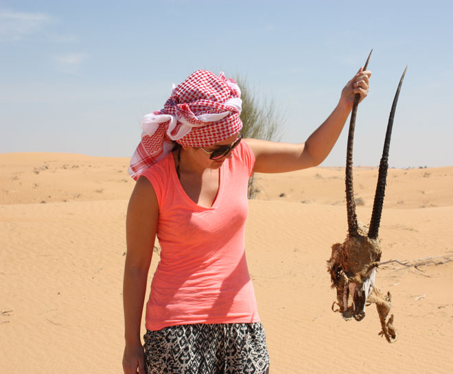 Platinum Heritage - Desert Safari Dubai - Breakfast with a Bedouin - Holding Arabian Oryx skull in the desert