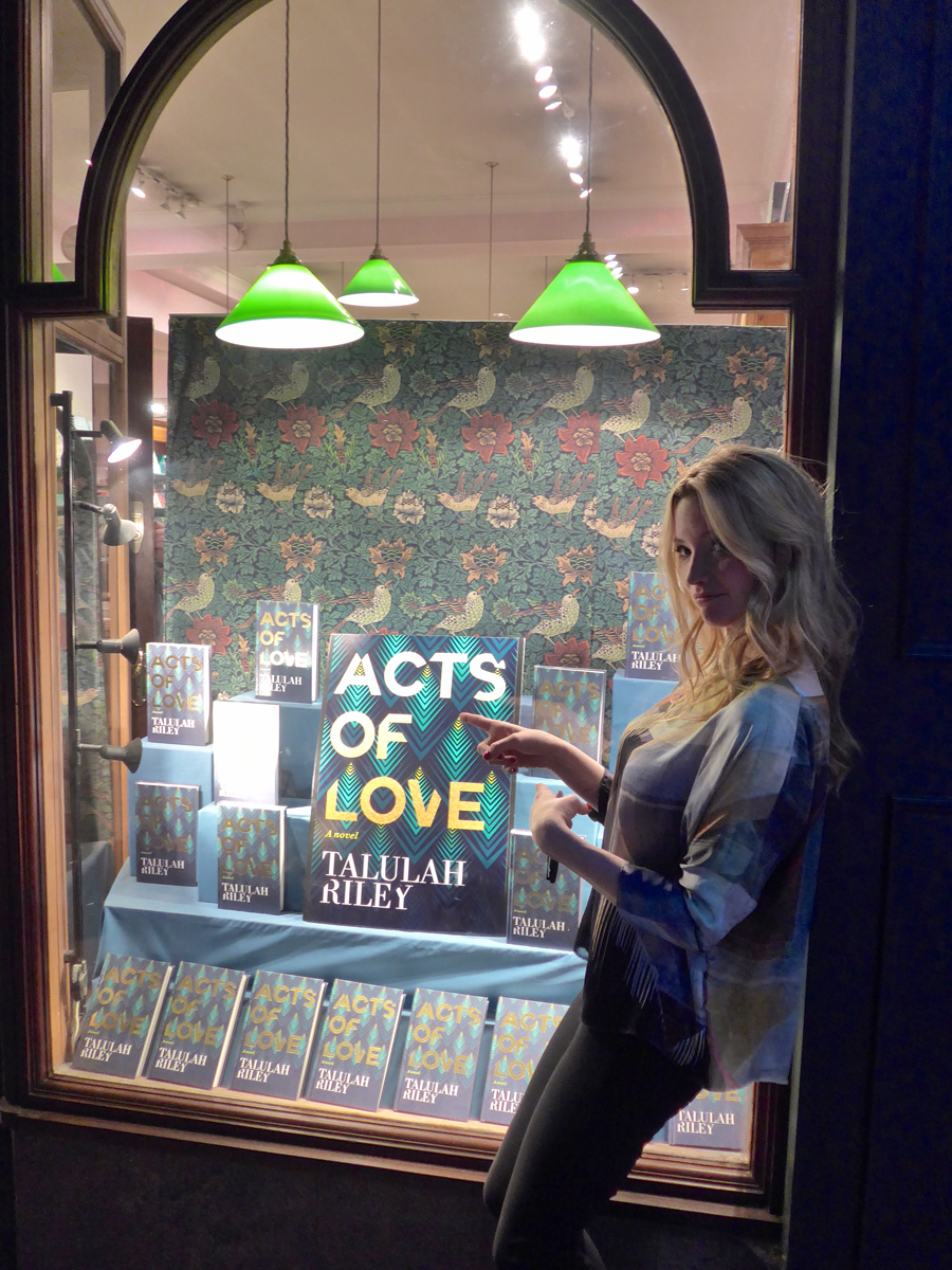 Talulah Riley admiring the Daunt Books display of her hot new release Acts of Love