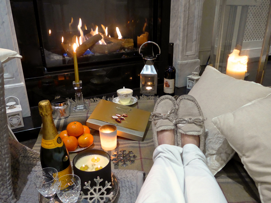 Get-your-Hygge-on---cosy-fireplace-candles-and-ugg slippers