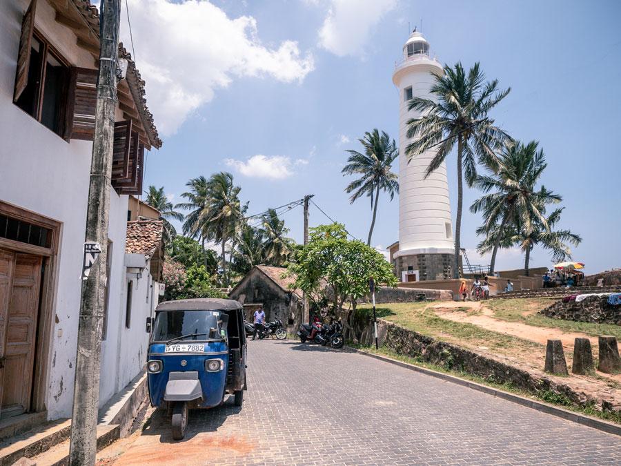 Galle fort. Lighthouse and tuk tuk Sri Lanka